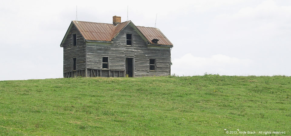 Old farm house with commanding presence, near Gasburg, Va.  Photo by Andy Brack.
