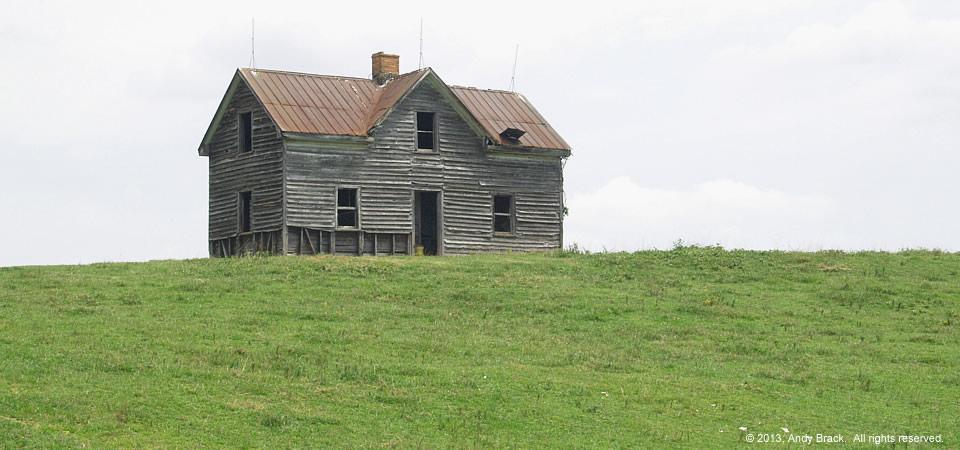 Old farm house with commanding presence, near Gasburg, Va.  Photo by Andy Brack.