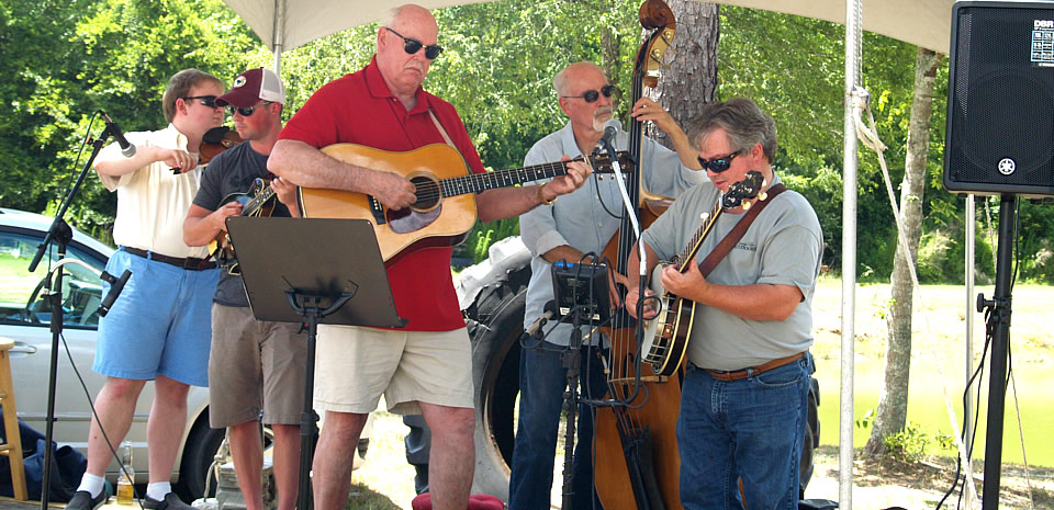 A bluegrass group jams at a June event on David Anderson's organic blueberry farm in Bamberg County in the middle of the Promise Zone.