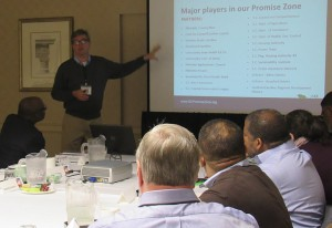 Better South's Andy Brack, in background, leads a discussion during the conference.
